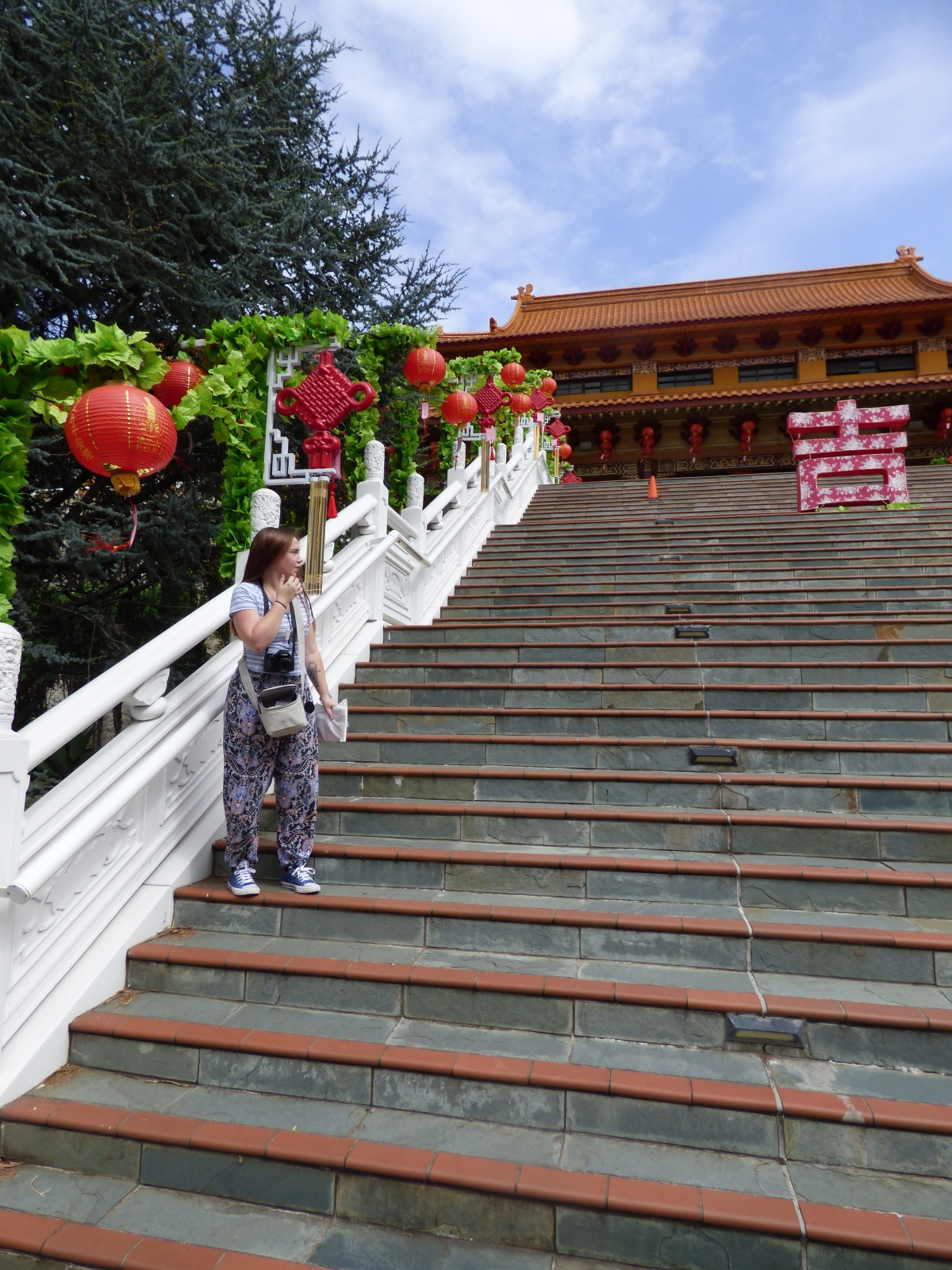 On the temple steps at Nan Tien.